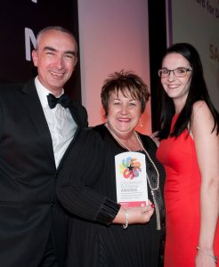 Head of HR for SAS Daniels LLP, Chris Swerling collecting the Stockport Business Award for Developing Young People