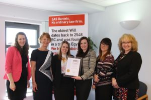 SAS Daniels' employees being presented with the STEP Gold Accreditation.