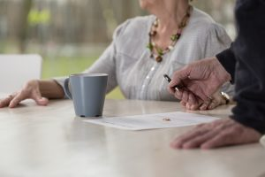 Pension Sharing in Divorce - Elderly couple signing papers
