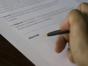 Signing a cohabitation agreement document
