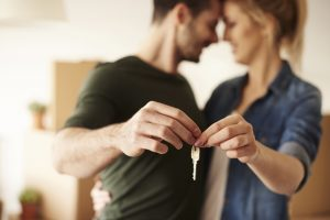 Cohabiting couple in love with key to new home