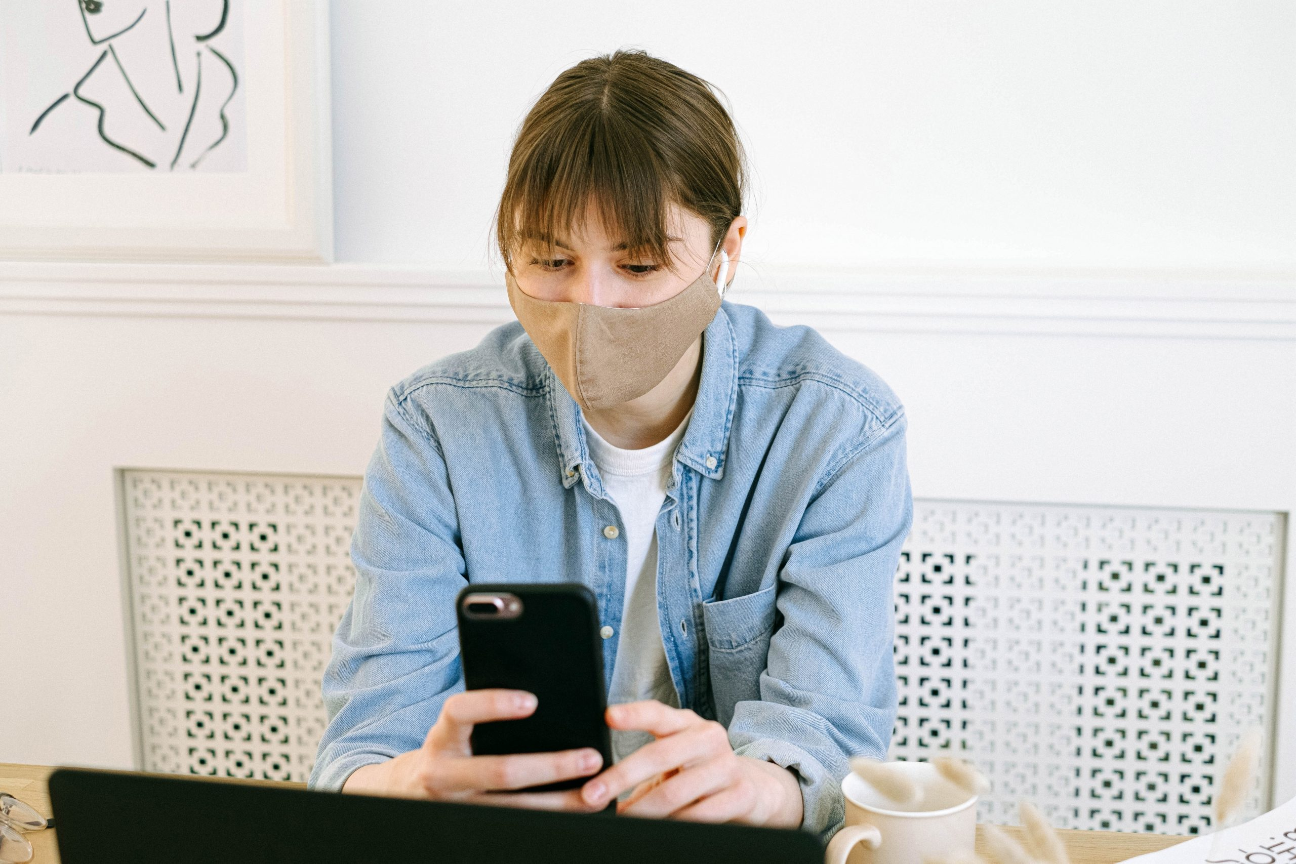 woman wearing mask considering COVID-19 testing in the workplace