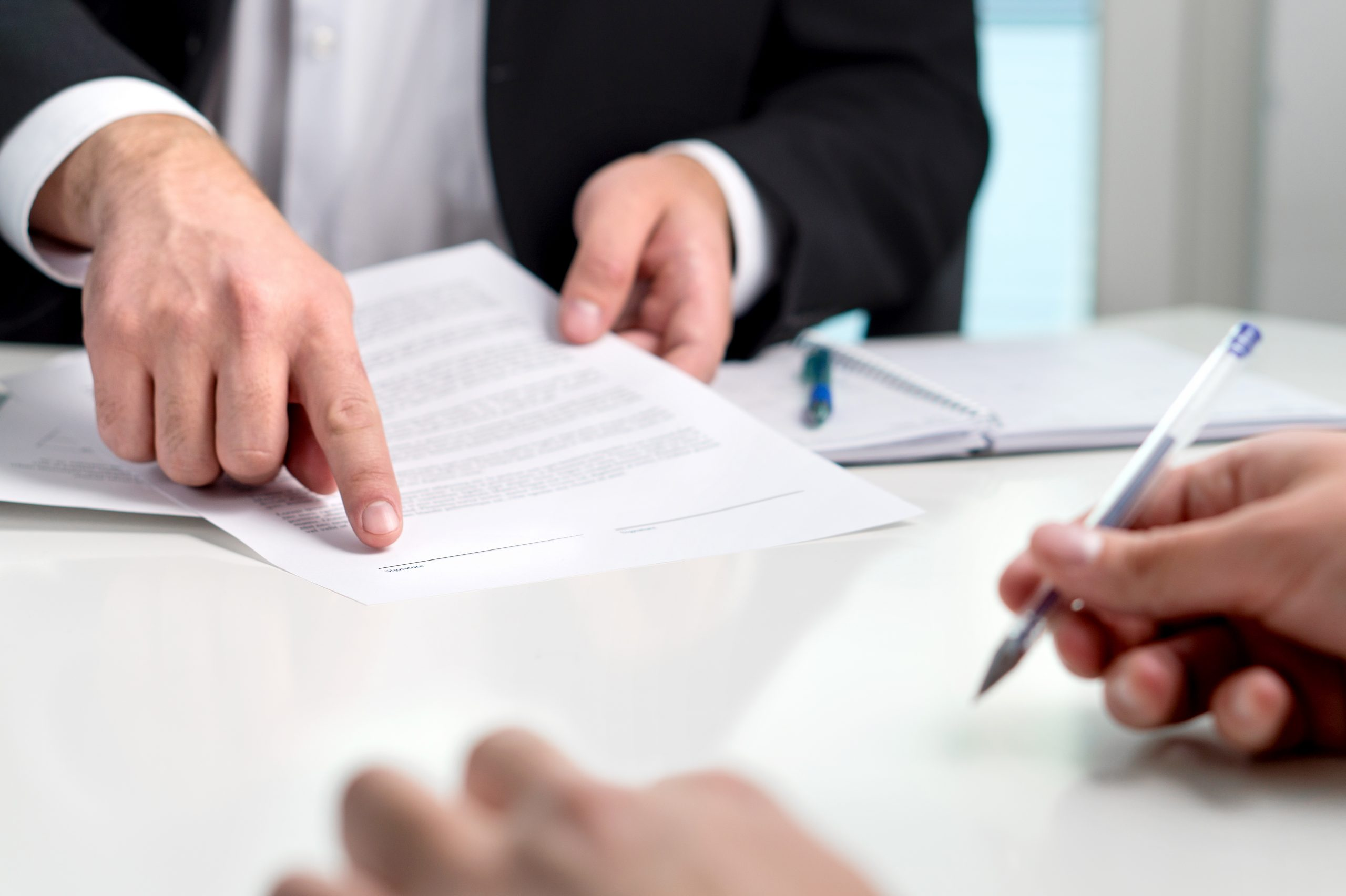 Man signing document of his expression of wish