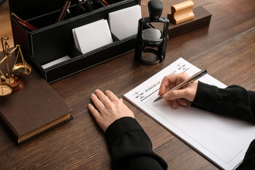 Person writing powers of attorney document